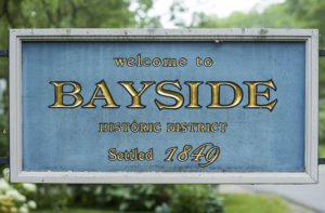 sign welcoming visitors to Bayside's historic district