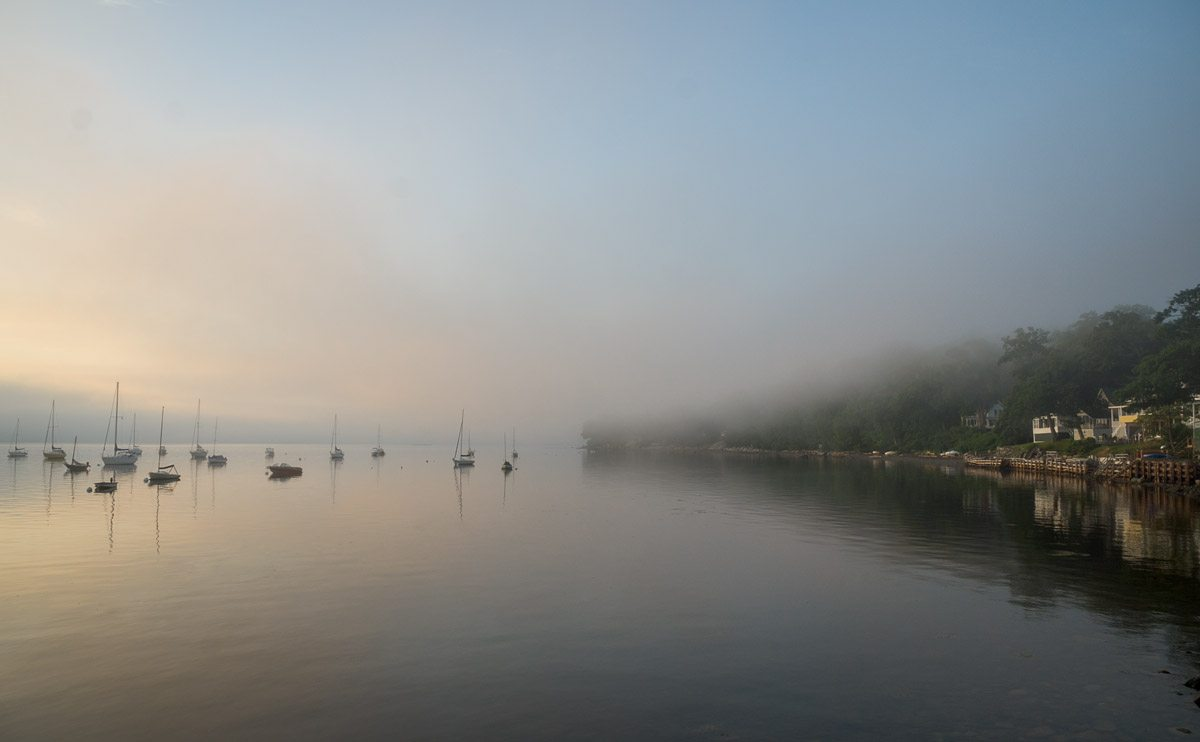 Bayside harbor and south shore as morning fog burns off