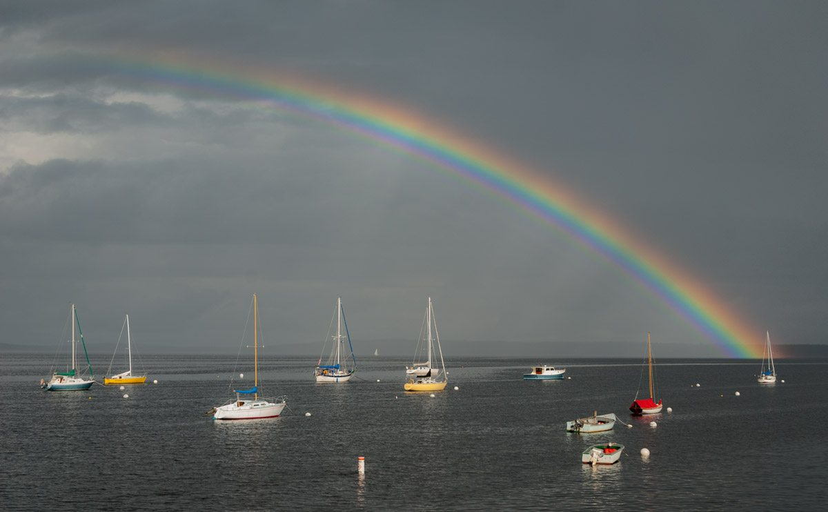 rainbow over boats in Bayside harbor