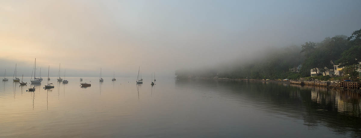 boats in harbor and clearing fog from Bayside's south shore