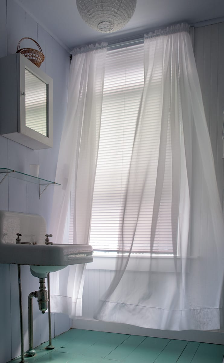 Soft breeze ruffles sheer curtain.