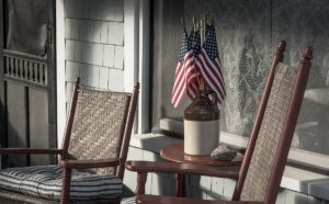 Small flags arranged like a flower arrangement on a summer cottage porch