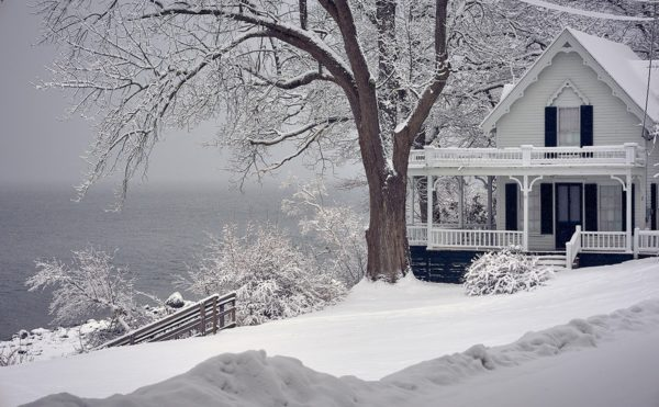 white cottage surrounded by snow