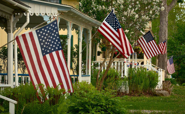 summer cottages each with an American flags
